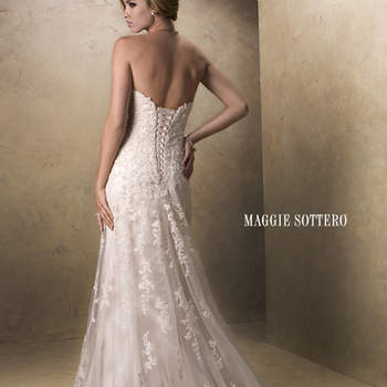 """With an eye to timeless romance, this slim A-line design features a delicate, sweetheart neckline and gorgeous beaded lace motifs dancing across tulle. Available with corset back or zipper closure. Detachable cap-sleeves offered separately. Extended train also available (Emma Marie).  <a href=""""http://www.maggiesottero.com/dress.aspx?style=13533"""" target=""""_blank"""">Maggie Sottero Platinum 2015</a>"""
