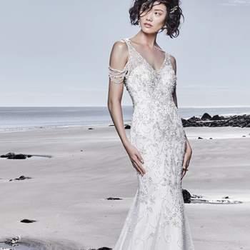 """<a href=""""https://www.maggiesottero.com/sottero-and-midgley/georgina/11535"""">Maggie Sottero</a> <br> Rassemblant le glamour et le raffinement de la tradition hollywoodienne, cette robe de mariée avec corsage d'inspiration vintage en tulle est ornée de motifs de perles et de cristaux Swarovski."""