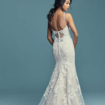 """<a href=""""https://www.maggiesottero.com/maggie-sottero/riley/11502"""">Maggie Sottero</a>  Beaded lace motifs dance over sequin tulle in this soft yet alluring sheath wedding gown, completing the unique illusion keyhole back. Beaded spaghetti straps complete the elegant scoop neckline. Finished with covered buttons over zipper closure."""