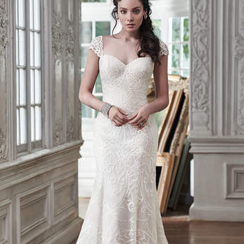 """Timeless and classic, this slim A-line wedding dress is the epitome of beauty with romantic lace and an alluring sweetheart neckline. Available with corset closure or covered button over zipper closure. Detachable cap-sleeves sold separately. <a href=""""https://www.maggiesottero.com/maggie-sottero/mirian/9488"""" target=""""_blank"""">Maggie Sottero</a>"""