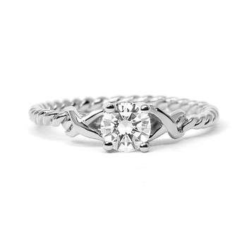 Braided Engagement - Ideal for the classical bride, the rope band and solitaire diamond combine for an eye-catching and memorable ring for a timeless piece of jewelry. The perfect family heirloom in the years to come.