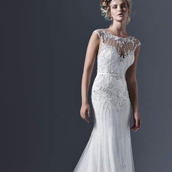 """Tull glamour et perles sur un fourreau pour cette concfection romantique de la maison. Le décolleté illusion est magnifique et scintillant grâce à des cristaux Swarovski. Une ceinture de satin avec embellissement de cristal met l'accent sur la taille de la mariée.   <a href=""""http://www.sotteroandmidgley.com/dress.aspx?style=5SW627"""" target=""""_blank"""">Sottero &amp; Midgley</a>"""