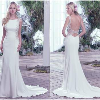 "A dramatic scoop back is accented with an illusion closure creating a sexy keyhole below the natural waist. Artfully placed lace embellishments featuring Swarovski crystals adorn each illusion side panel adding a modern twist to this Yolivia Crepe satin sheath wedding dress with high bateau neckline. Finished with a zipper closure.   <a href=""https://www.maggiesottero.com/maggie-sottero/andie/9751"" target=""_blank"">Maggie Sottero</a>"