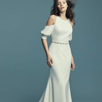 """<a href=""""https://www.maggiesottero.com/maggie-sottero/claudia/11433"""">Maggie Sottero</a>  Comprised of Aldora Crepe, this soft fit-and-flare wedding dress features cold-shoulder sleeves, a jewel neckline, and a scoop back. The skirt is lined with shapewear for a figure-flattering fit. Finished with zipper closure. Aldora Crepe belt is included with this style. Jeweled belt on satin ribbon accented in Swarovski crystals sold separately."""