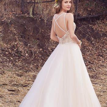 Ein Ballkleid der Extraklasse ist das Brautkleid Janessa. Besonders schön: die überkreuzten Träger im Rückenbereich.