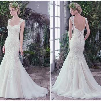 """Lace and sequins are artfully placed atop tulle in this feminine fit and flare wedding dress. Finished with a soft sweetheart neckline and corset closure. Lace cap-sleeves sold separately.   <a href=""""https://www.maggiesottero.com/maggie-sottero/gia/9763"""" target=""""_blank"""">Maggie Sottero</a>"""