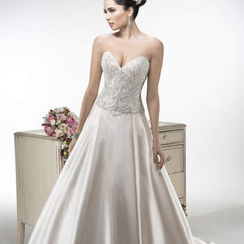 "Heavily beaded embroidered bodice, sprinkled with Swarovski crystals, graces this Delustered satin ballgown, finished with sweetheart neckline. Finished with covered buttons and zipper over inner corset back closure. Available with detachable illusion cap-sleeves.  <a href=""http://www.maggiesottero.com/dress.aspx?style=4MS924"" target=""_blank"">Maggie Sottero Platinum 2015</a>"