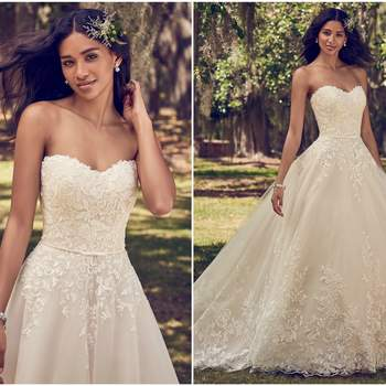 """Lace motifs cascade over tulle in this ballgown wedding dress, featuring a strapless scoop neckline and belt with bow detail. Finished with covered buttons over zipper and inner corset closure.  <a href=""""https://www.maggiesottero.com/maggie-sottero/viola/11199?utm_source=zankyou&amp;utm_medium=gowngallery"""" target=""""_blank"""">Maggie Sottero</a>"""