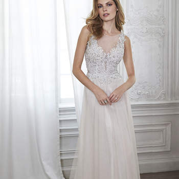 "Modern romance is found in this tulle A-line wedding dress featuring an intricate lace bodice accented with Swarovski crystals, plunging illusion neckline, and scalloped back. Finished with zipper closure.  <a href=""http://www.maggiesottero.com/dress.aspx?style=5MT033"" target=""_blank"">Maggie Sottero Spring 2015</a>"