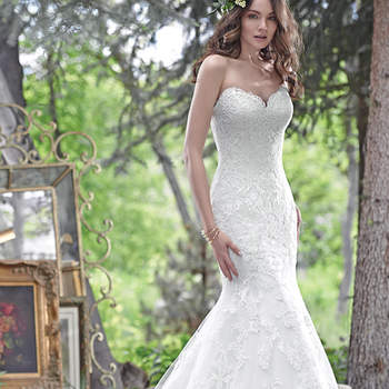 """Elegant and timeless, this fit and flare wedding dress features embroidered lace on tulle and a romantic, scalloped lace sweetheart neckline, creating a show-stopping silhouette. Finished with corset closure. <a href=""""www.maggiesottero.com/maggie-sottero/cadence/9539"""" target=""""_blank"""">Maggie Sottero</a>"""