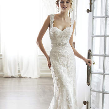 """The pinnacle of romance is found in this streamlined sheath rendered in exquisite lace. Complete with dramatic V-back beautifully detailed with illusion lace, sweetheart neckline and delicate cap-sleeves. Finished with covered button over zipper and inner elastic closure and optional grosgrain ribbon belt with beaded motif. Detachable belt sold separately. <a href=""""http://www.maggiesottero.com/dress.aspx?style=5MN083&amp;page=0&amp;pageSize=36&amp;keywordText=&amp;keywordType=All"""" target=""""_blank"""">Maggie Sottero</a>"""