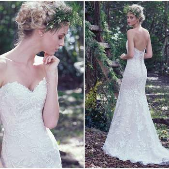 "Floral appliqués sparkle throughout this classic lace fit and flare wedding dress. Three dimensional flowers adorned with Swarovski crystals add texture and femininity to the skirt. Finished with a soft sweetheart neckline and corset closure.   <a href=""https://www.maggiesottero.com/maggie-sottero/trena/9714"" target=""_blank"">Maggie Sottero</a>"