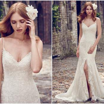 """Layers of delicate lace motifs and textured tulle comprise this fit-and-flare wedding dress, featuring a V-neckline, spaghetti straps, and a slit in the front. Finished with covered buttons over zipper and inner elastic closure.  <a href=""""https://www.maggiesottero.com/maggie-sottero/calista/11161?utm_source=zankyou&amp;utm_medium=gowngallery"""" target=""""_blank"""">Maggie Sottero</a>"""