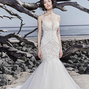 "Shimmering lace motifs and Swarovski crystals adorn the bodice of this sexy fit-and-flare wedding dress, completing the illusion plunging sweetheart neckline, spaghetti straps, and scoop back. Subtle beading trims the tulle and horsehair skirt. Finished with covered buttons over zipper closure.  <a href=""https://www.maggiesottero.com/sottero-and-midgley/nouvelle/11559"">Sottero and Midgley</a>"