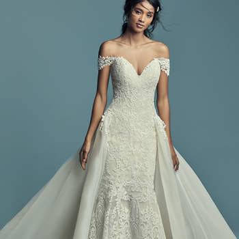 "<a href=""https://www.maggiesottero.com/maggie-sottero/stephanie/11435"">Maggie Sottero</a>  Elegant and romantic, this soft fit-and-flare wedding dress features allover lace motifs atop tulle, completing the strapless plunging sweetheart neckline. Lined with shapewear for a figure-flattering fit, and finished with covered buttons over zipper closure. Illusion off-the-shoulder cap-sleeves accented in lace motifs sold separately. Detachable tulle train accented in lace motifs sold separately."