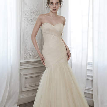 """A stunning fit and flare wedding dress featuring pleated tulle and flaring into a voluminous skirt, complete with romantic sweetheart neckline and finished with corset closure. <a href=""""https://www.maggiesottero.com/maggie-sottero/lacey/8284"""" target=""""_blank"""">Maggie Sottero</a>"""