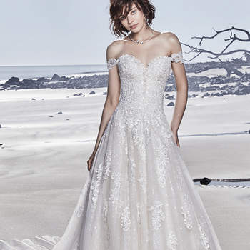 "This dramatic princess wedding dress features layers of lace motifs, sequin tulle, and textured tulle, with beading along the bodice. Complete with sheer plunging sweetheart neckline accented in lace motifs. Finished with crystal buttons over zipper and inner corset closure. Illusion off-the-shoulder cap-sleeves accented in lace motifs sold separately.  <a href=""https://www.maggiesottero.com/sottero-and-midgley/glenn/11536"">Sottero and Midgley</a>"