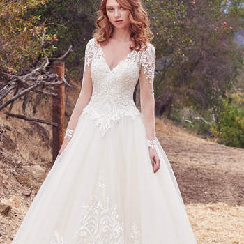 Lace appliqués cascade over the bodice, illusion long-sleeves, illusion V over sweetheart neckline, and illusion V-back in this breathtaking ballgown. Voluminous tulle skirt features lace appliqués along the hemline. Finished with covered buttons over zipper closure.