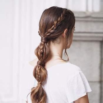 Penteado para noiva com cabelo preso e trança   Foto: Urvan
