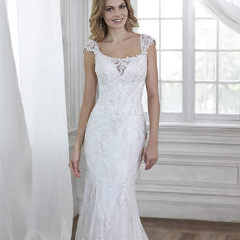 "Exquisitely embroidered and showered in delicate lace appliques, this gown was made for the feminine bride. Complete with plunging illusion neckline, lace cap-sleeves, and dramatic plunging back. Finished with crystal button over zipper closure.  <a href=""http://www.maggiesottero.com/dress.aspx?style=5MT031"" target=""_blank"">Maggie Sottero Spring 2015</a>"