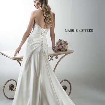 "Glimmering Rosario Crepe Back Satin A-line gown finished with dazzling Swarovski crystals along a feminine sweetheart neckline and accenting the hip. Corset back closure cinches the waist, creating an hourglass shape.  <a href=""http://www.maggiesottero.com/dress.aspx?style=4MW039"" target=""_blank"">Maggie Sottero Platinum 2015</a>"