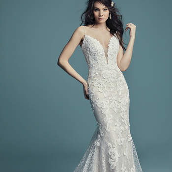 "<a href=""https://www.maggiesottero.com/maggie-sottero/tuscany/11513"">Maggie Sottero</a>  Shimmering lace motifs waltz over allover lace in this romantic sheath wedding dress, comprised of tulle. Beaded spaghetti straps complete the lined bodice and illusion plunging sweetheart neckline. Finished with covered buttons over zipper closure."