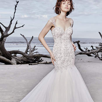 "Dazzling beaded lace motifs and Swarovski crystals waltz over the  bodice of this wedding dress, completing the strapless sweetheart neckline. Tulle fit-and-flare skirt trimmed with beading and horsehair. Finished with corset closure. Illusion cap-sleeves accented in beaded lace motifs sold separately.   <a href=""https://www.maggiesottero.com/sottero-and-midgley/jefferson/11543"">Sottero and Midgley</a>"