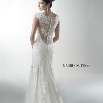 """Mirroring the sophistication of Savannah, this sister dress includes sequined embellished lace over a separate slip dress. Cap-sleeves accent a low, illusion back. Finished with crystal buttons over zipper back closure. Offered with Monroe slip dress or slip dress with raised back.  <a href=""""http://www.maggiesottero.com/dress.aspx?style=4MW060"""" target=""""_blank"""">Maggie Sottero Platinum 2015</a>"""