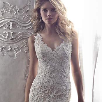 "Intricate all over lace adorns this sheath wedding dress with plunging, sleeveless neckline and sexy keyhole back. Finished with covered buttons over zipper back closure.  <a href=""http://www.maggiesottero.com/dress.aspx?style=5MT075"" target=""_blank"">Maggie Sottero Spring 2015</a>"