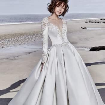 """<a href=""""https://www.maggiesottero.com/sottero-and-midgley/brennon/11523"""">Maggie Sottero</a> <br> Cette robe de mariée en satin à couper le souffle est dotée de manches longues rehaussées de détails et de perles exquises."""
