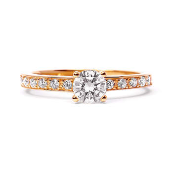 Aurora Borealis - A gorgeous ring with a 360 degree sparkle thanks to the smaller diamonds studded on the band. The central solitaire diamond is sure to win over any sweetheart with its modern twist on the traditional pre-matrimonial ring.