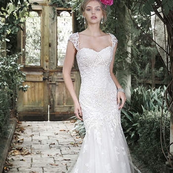 "This lace fit and flare wedding dress channels timeless elegance with its classic sweetheart neckline, cascading floral lace appliqués and flared tulle skirt. Lace cap-sleeves offered separately. Finished with corset closure.  <a href=""http://www.maggiesottero.com/dress.aspx?style=5MC688"" target=""_blank"">Maggie Sottero</a>"