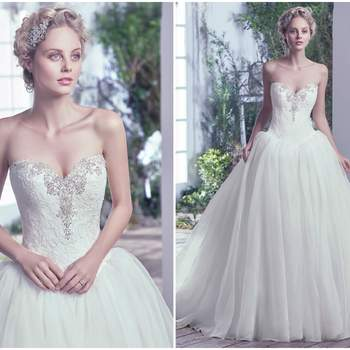"Exuding refined Victorian beauty, this Chic organza ball gown with lace bodice featuring Swarovski crystals and embellished accents along a sweetheart neckline makes a grand statement. Finished with a corset closure.   <a href=""https://www.maggiesottero.com/maggie-sottero/ginny/9725"" target=""_blank"">Maggie Sottero</a>"