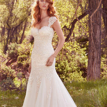 "Striking lace appliqués adorn the bodice of this romantic fit-and-flare, featuring a sweetheart neckline and godets in the airy tulle and English netting skirt. Finished with covered buttons over zipper and inner elastic closure. Detachable cap-sleeves with lace appliqués sold separately.   <a href=""https://www.maggiesottero.com/maggie-sottero/perla/10130?utm_source=mywedding.com&amp;utm_campaign=spring17&amp;utm_medium=gallery"" target=""_blank"">Maggie Sottero</a>"