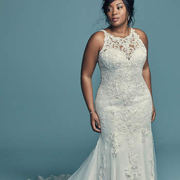 """<a href=""""https://www.maggiesottero.com/maggie-sottero/kendall-lynette/11489"""">Maggie Sottero</a>  This classic yet striking wedding gown offers additional coverage to our Kendall style. Fit-and-flare silhouette features beaded lace motifs, crosshatch details, and Swarovski crystals over tulle. Lace motifs adorn the illusion halter over sweetheart neckline and illusion back. An illusion double-lace train completed the elegant romance of this look. Finished with covered buttons over zipper closure."""