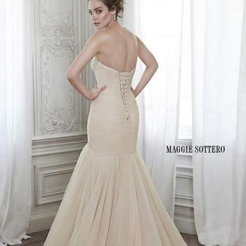 """Con ajuste impresionante, este vestido de novia de tul plisado con terminación voluminosa a través de su falda voluminosa, se complementa con un romántico escote corazón y termina con corsé. Disponible con una cinta floral desmontable como opción, hecho totalmente a mano.  <a href=""""http://www.maggiesottero.com/dress.aspx?style=5MZ134"""" target=""""_blank"""">Maggie Sottero Spring 2015</a>"""