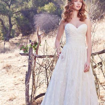 Wer den Vintage-Stil liebt, der wird das Brautkleid Marta lieben. Feiner Stoff trifft auf trägerloses Dekolleté.