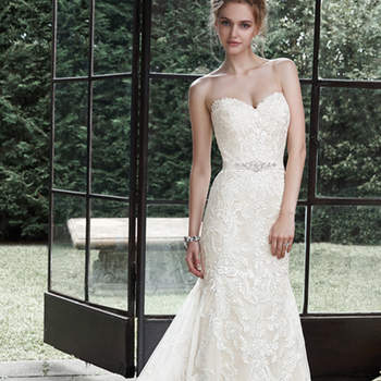 """Dreamy lace and tulle combine to create this elegant fit and flare wedding dress, accented with timeless sweetheart neckline. A glittering Swarovski crystal motif on an optional grosgrain ribbon belt adds a touch of drama. Finished with covered buttons over zipper and inner elastic closure. <a href=""""http://www.maggiesottero.com/dress.aspx?style=5MS694"""" target=""""_blank"""">Maggie Sottero</a>"""