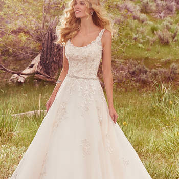 "This romantic ballgown features embroidered lace appliqués that accent the bodice, straps, and illusion trim along the scoop front and back, and eventually cascade into a voluminous tulle skirt. Accented with a dazzling pearl and Swarovski crystal motif at the waistline. Finished with crystal buttons over zipper closure.  <a href=""https://www.maggiesottero.com/maggie-sottero/tayla/10146?utm_source=mywedding.com&amp;utm_campaign=spring17&amp;utm_medium=gallery"" target=""_blank"">Maggie Sottero</a>"
