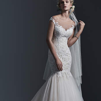 Bold patterned lace adorns a portrait illusion front and back neckline in this stunning mermaid wedding dress, complete with flared tulle skirt. Finished with covered buttons over zipper closure. <img height='0' width='0' alt='' src='http://ads.zankyou.com/mn8v' />