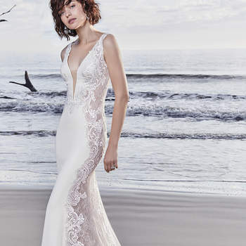 "Sheer lace and lace motifs comprise the side insets, statement back, and statement train in this Vesna Crepe sheath wedding dress, creating a uniquely sexy look. Elegant straps complete the illusion plunging neckline. Lined with Inessa Jersey for a figure-flattering look. Finished with covered buttons over zipper closure.  <a href=""https://www.maggiesottero.com/sottero-and-midgley/bradford-rose/11522"">Sottero and Midgley</a>"