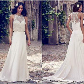 "An attached sleeveless illusion jacket accented in beading and Swarovski crystals overlays this vintage-inspired wedding dress, creating an illusion crew over sweetheart neckline. A-line gown comprised of Orlando Satin. Finished with crystal button over zipper closure.  <a href=""https://www.maggiesottero.com/maggie-sottero/larkin/11176?utm_source=zankyou&amp;utm_medium=gowngallery"" target=""_blank"">Maggie Sottero</a>"