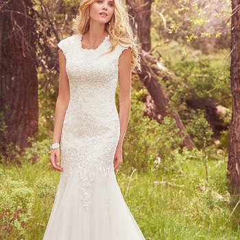 "Lace motifs adorn the bodice of this modest fit-and-flare, while godets add dimension to the gown's simple tulle skirt. Featuring a jewel neckline and cap-sleeves. Finished with covered buttons over zipper and inner elastic closure.   <a href=""https://www.maggiesottero.com/maggie-sottero/perla-marie/10157?utm_source=mywedding.com&amp;utm_campaign=spring17&amp;utm_medium=gallery"" target=""_blank"">Maggie Sottero</a>"