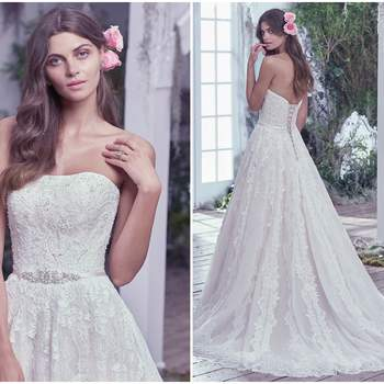 """A sweet yet sophisticated tulle ball gown, adorned with embroidered lace, features a strapless fitted bodice, beaded belt with Swarovski crystals, and effortlessly full skirt with a gorgeous lace hemline. Finished with a corset closure.   <a href=""""https://www.maggiesottero.com/maggie-sottero/temperance/9693"""" target=""""_blank"""">Maggie Sottero</a>"""