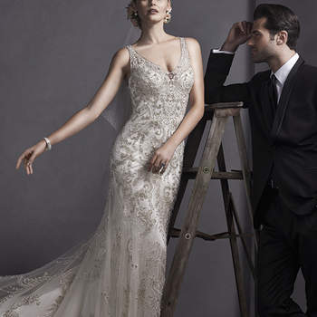 """Elegance is found in this fully beaded embroidered lace  sheath dress, complete with Swarovski crystals and lavish bead patterns, cascading down a tulle floor-length skirt. Finished with V-neckline, straps and pearl button and zipper closure.   <a href=""""http://www.sotteroandmidgley.com/dress.aspx?style=5SW070"""" target=""""_blank"""">Sottero and Midgley Spring 2015</a>"""