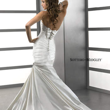 "Simple elegance, this rich Soft Shimmer Satin in relaxed mermaid silhouette features a ruched bodice with sweetheart neckline, bubble hem and Swarovski crystal motifs. Finished with zipper over inner corset closure with bow and crystal button detail.  <a href=""http://www.sotteroandmidgley.com/dress.aspx?style=72633"" target=""_blank"">Sottero &amp; Midgley Platinum 2015</a>"