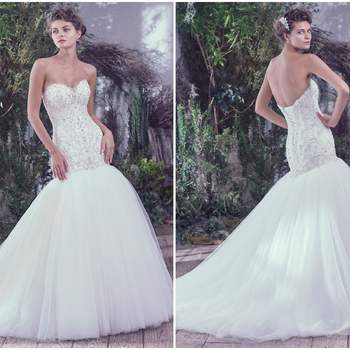 "Intricate embroidery and beaded embellishments featuring Swarovski crystals are artistically woven onto the fitted drop waist bodice of this feminine fit and flare wedding dress. A soft scoop neckline and a voluminous tulle skirt add an extra dose of romantic elegance. Finished with corset closure or covered buttons over zipper closure.   <a href=""https://www.maggiesottero.com/maggie-sottero/daryl/9691"" target=""_blank"">Maggie Sottero</a>"
