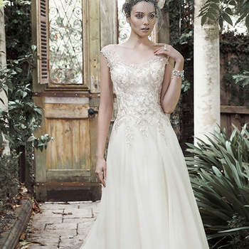"""<a href=""""http://www.maggiesottero.com/dress.aspx?style=5MR709"""" target=""""_blank"""">Maggie Sottero</a>"""