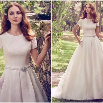 """This sweet and elegant ballgown features Vega Organza with a novelty floral print. A jewel neckline, short sleeves, and sheer pockets complete the ethereal romance of this wedding dress. Finished with pearl buttons over zipper and inner elastic closure. Pearl and Swarovski crystal belt featuring beaded brooch sold separately.   <a href=""""https://www.maggiesottero.com/maggie-sottero/dylan-marie/11168?utm_source=zankyou&amp;utm_medium=gowngallery"""" target=""""_blank"""">Maggie Sottero</a>"""