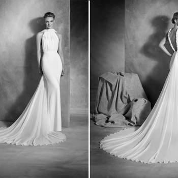 Anspruchsvolles Meerjungfrauen-Brautkleid aus Crepe und Seidenchiffon mit Deckholder-Ausschnitt. Strass-Applikationen und die niedrige Taille werden zum Hingucker.